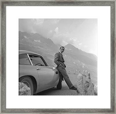 James Bond And His Aston Martin Framed Print by Georgia Fowler