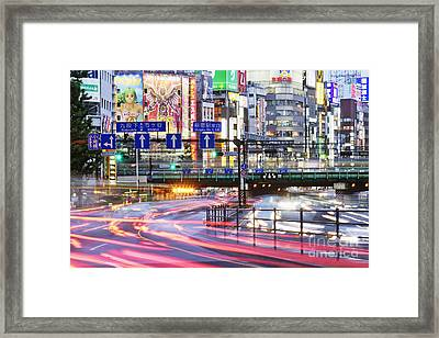 Japanese Downtown Traffic At Dusk Framed Print by Jeremy Woodhouse