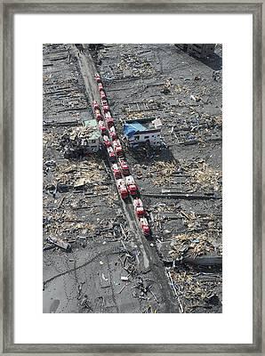 Japanese Fire Trucks Line A Road Framed Print by Stocktrek Images