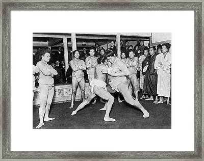 Japanese Sumo Wrestlers Framed Print by Underwood Archives