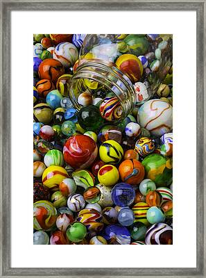 Jar Pouring Out Glass Marbles Framed Print by Garry Gay