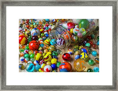Jar Spilling Colorful Marbles Framed Print by Garry Gay