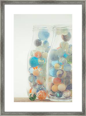 Jars Full Of Marbles Framed Print by Edward Fielding