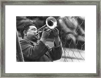 Jazz Behind A Fence Framed Print by Emanuel Tanjala