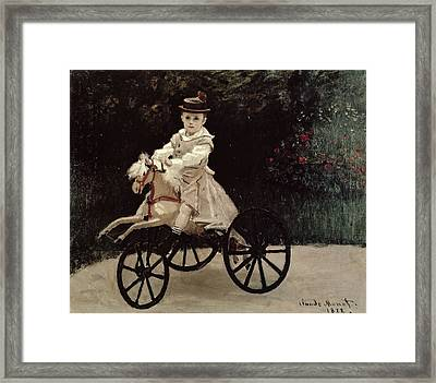 Jean Monet On His Hobby Horse Framed Print by Claude Monet