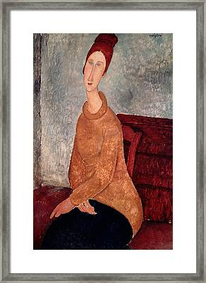 Jeanne Hebuterne In A Yellow Jumper Framed Print by Amedeo Modigliani