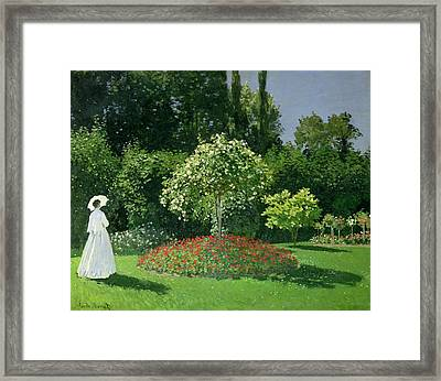 Jeanne Marie Lecadre In The Garden Framed Print by Claude Monet