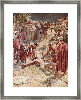 Jesus Being Crucified Framed Print