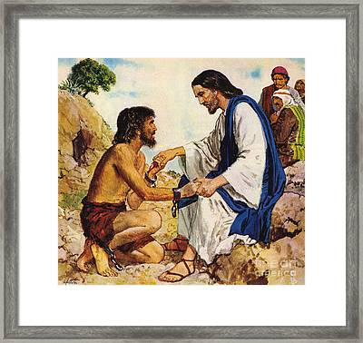 Jesus Christ Cures A Madman Framed Print by Clive Uptton