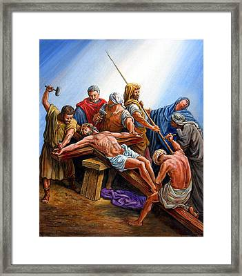 Jesus Nailed To The Cross Framed Print by John Lautermilch