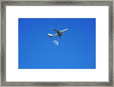 Jet Plane Flying Over The Moon Framed Print