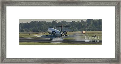 Jet Plane Landing On Runway With Tires Smoking Framed Print by David Oppenheimer