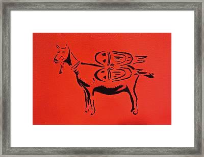 Jetpack Goat Framed Print by Tom Evans