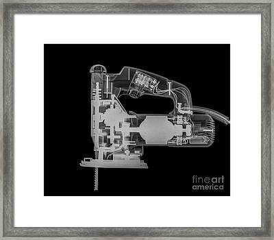 Jigsaw Under X-ray  Framed Print by Guy Viner