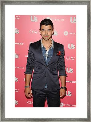 Joe Jonas Wearing A Calvin Klein Suit Framed Print