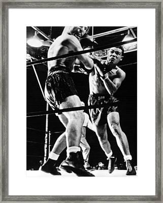Joe Louis Delivers Knockout Punch Framed Print