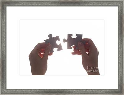 Joining Two Pieces Of Jigsaw Puzzle Framed Print