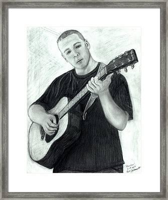 Jonathan Playing Guitar Framed Print by Bob Schmidt