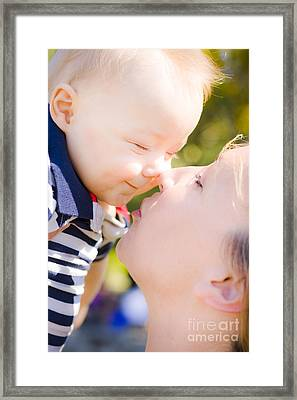 Joyful Baby Rubbing Noses With Mom Framed Print