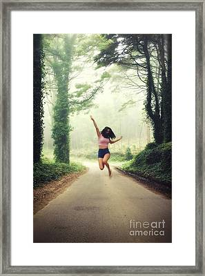 Joyful Jump Framed Print by Carlos Caetano