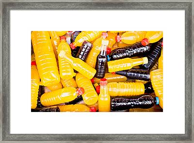 Juice Bottles Framed Print by Tom Gowanlock