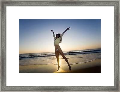 Jump - Beach Framed Print by Brad Rickerby