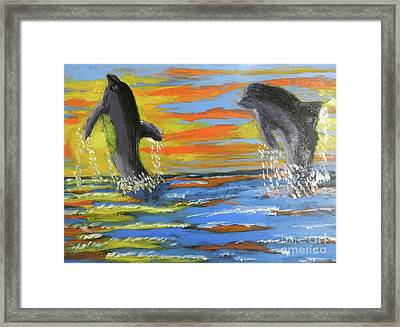 Jumping Dolphins Framed Print