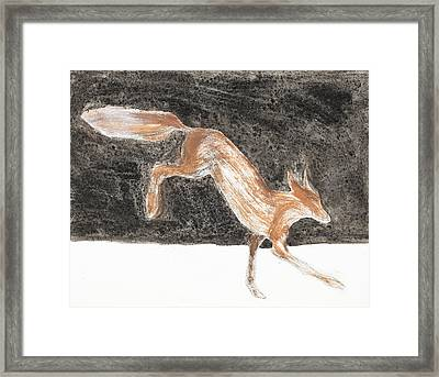 Jumping Fox In The Snow Framed Print by Sophy White