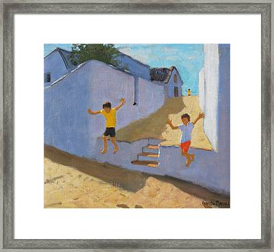 Jumping Off A Wall Framed Print by Andrew Macara