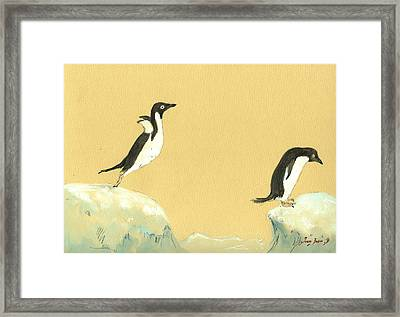 Jumping Penguins Framed Print by Juan  Bosco