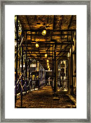 Just Passing Bye Framed Print by Andrew Kubica