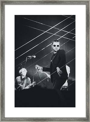 Kasabian Playing Live Framed Print by Marco Oliveira