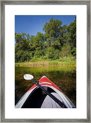 Kayak On A Forested Lake Framed Print