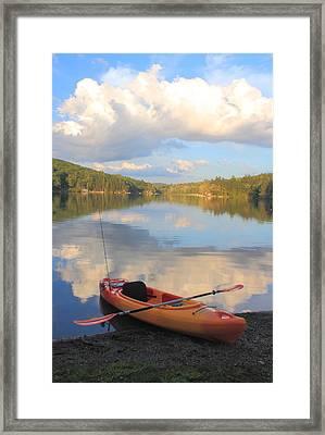 Kayak On Lake Framed Print by John Burk