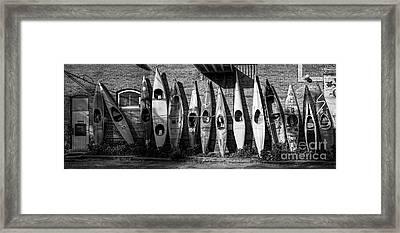 Kayaks And Canoes Framed Print