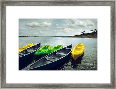 Kayaks Framed Print by Carlos Caetano