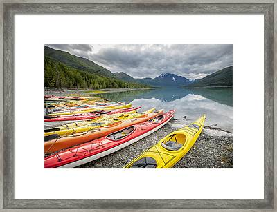 Kayaks In A Row On Shore At Eklutna Framed Print by Remsberg Inc