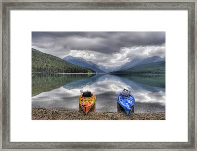Kayaks On Bowman Lake Framed Print by Donna Caplinger