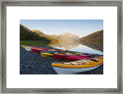 Kayaks On The Shore Of Eklutna Lake Framed Print by Michael DeYoung