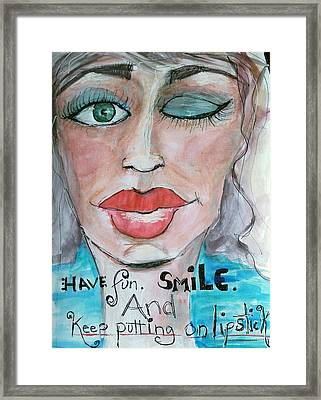 Keep Putting On Lipstick Framed Print