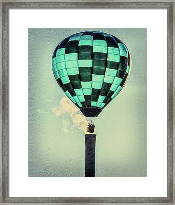 Keeping Warm As You Float Framed Print by Bob Orsillo