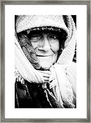 Keeping Warm Framed Print by Gabriela Insuratelu