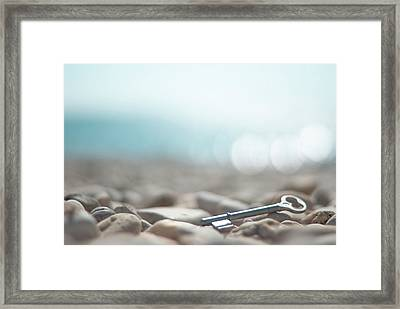 Key On Pebbles Framed Print by Alexandre Fundone