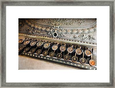 Key To Cash Framed Print