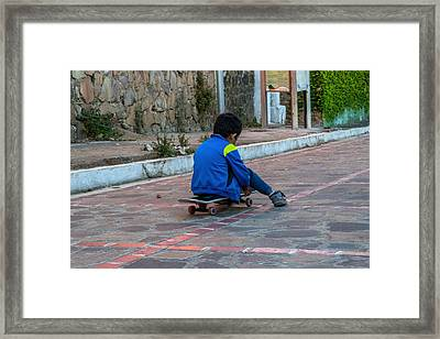 Kid Skateboarding Framed Print by Totto Ponce