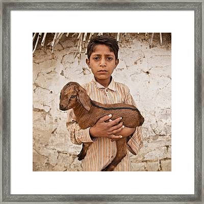 Kid With Goat Framed Print