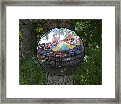Kiddie Ride Reflection In A Round Mirror Framed Print by Matt Plyler