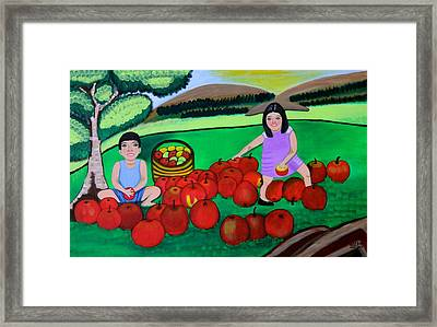 Kids Playing And Picking Apples Framed Print by Lorna Maza