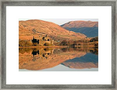 Kilchurn Castle In Autumn Framed Print by John McKinlay