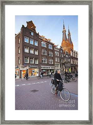 king a Walk in the Streets of Amsterdam Framed Print by Andre Goncalves